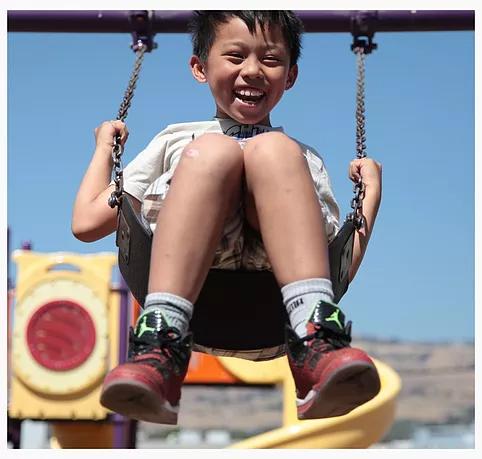 smiling boys swinging